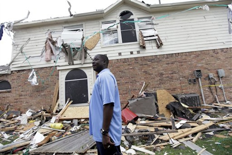 Charles Paige stands amongst tornado debris as he surveys the damage to his home Wednesday, April 4, 2012, in Forney, Texas. The mayor of Forney, Texas, says it's
