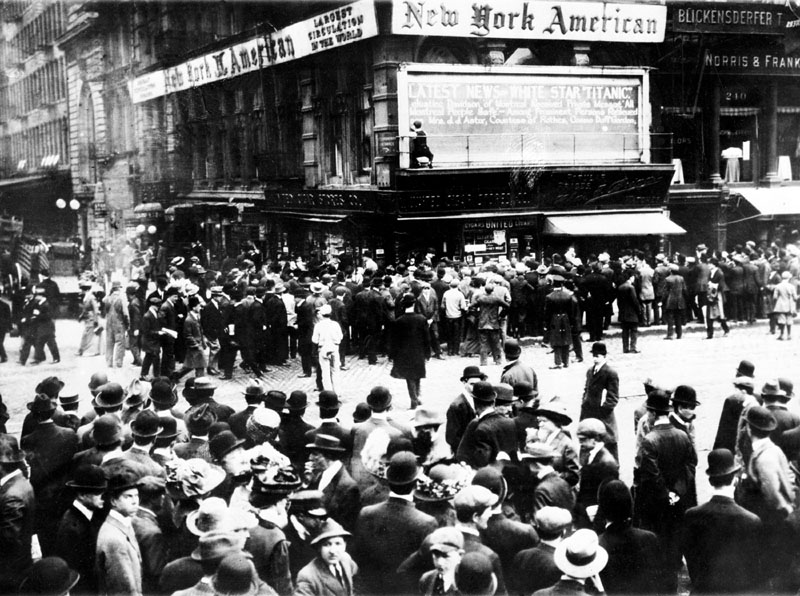 """HUGE STORY: In this April 1912 file photo, crowds gather around the bulletin board of the New York American newspaper in New York, where the names of people rescued from the sinking Titanic are displayed. It was a news story that would change the news. From the moment that a brief Associated Press dispatch relayed the wireless distress call _ """"Titanic ... reported having struck an iceberg. The steamer said that immediate assistance was required"""" _ reporters and editors scrambled. In ways that seem familiar today, they adapted a dawning newsgathering technology and organized saturation coverage and managed to cover what one authority calls """"the first really, truly international news event where anyone anywhere in the world could pick up a newspaper and read about it."""" Today marks the 100th anniversary of the luxury liner's sinking."""