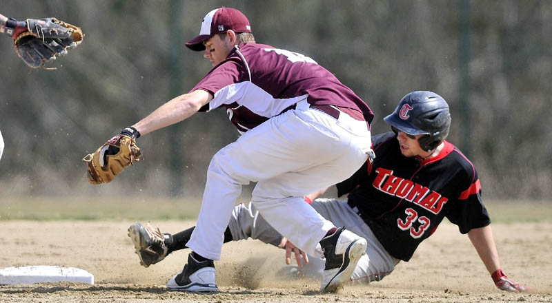 HUSTLE BACK: UMF shortstop Brett Wallingford, left, reaches back to tag second base as Thomas' Taylor Livingston tries to beat the play Wednesday in Waterville.