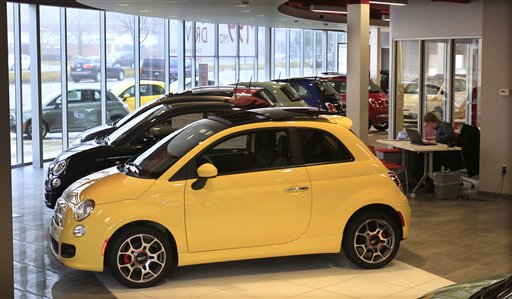 Fiat 500 vehicles are displayed at the Golling Fiat dealership in Birmingham, Mich. The Chrysler Group says its U.S. sales jumped 34 percent in March on strong sales of Fiat small cars and Chrysler sedans.