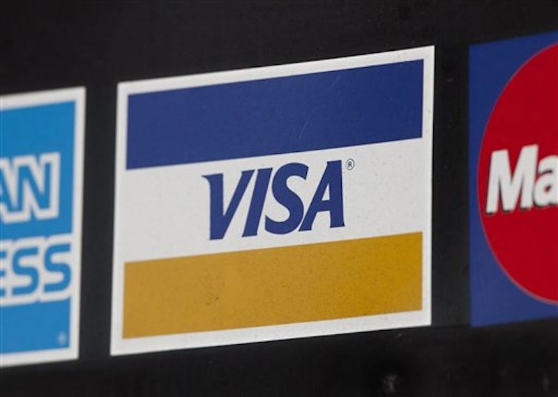 In this photo of March 19, 2012, a sign for Visa is shown in New York. (AP Photo/Mark Lennihan) CREDIT CARD DEBIT CARD