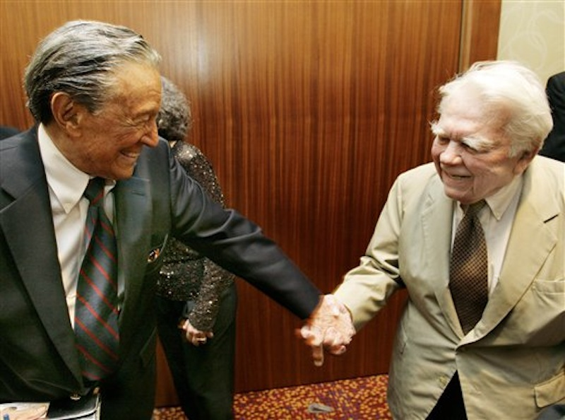 """In this May 12, 2007 photo CBS' 60 Minutes' Mike Wallace, left, greets colleague Andy Rooney during a reception at the 30th annual Boston/New England Emmy Awards in Boston. Wallace, famed for his tough interviews on """"60 Minutes,"""" has died, Saturday, April 7, 2012. He was 93. (AP Photo/CN8, Michael Dwyer)"""