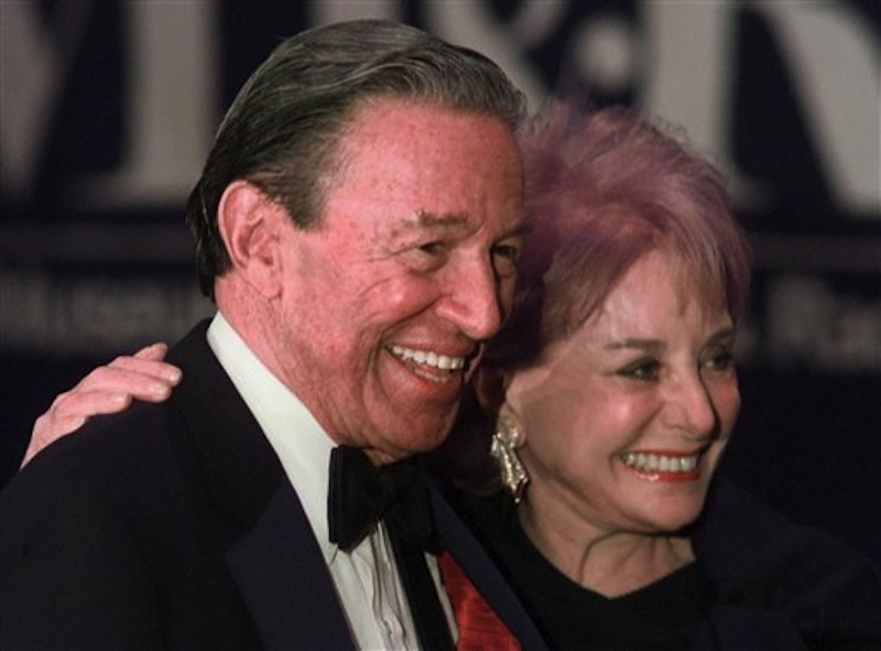 """In this Feb. 4, 1999 file photo, Barbara Walters and Mike Wallace pose for photographers before the start of a gala for The Museum of Television and Radio in New York. Wallace, the dogged, merciless reporter and interviewer who took on politicians, celebrities and other public figures in a 60-year career highlighted by the on-air confrontations that helped make """"60 Minutes"""" the most successful primetime television news program ever, has died. He was 93. (AP Photo/Mark Lennihan)"""