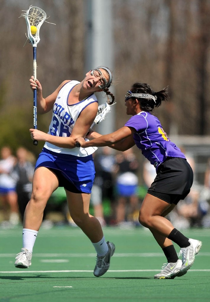 Staff Photo by Michael G. Seamans Colby College's Katie Griffin, 36,left, battles with Williams College defender, Meera Sivalingam, 10, in the first period at Colby College in Waterville on Saturday.