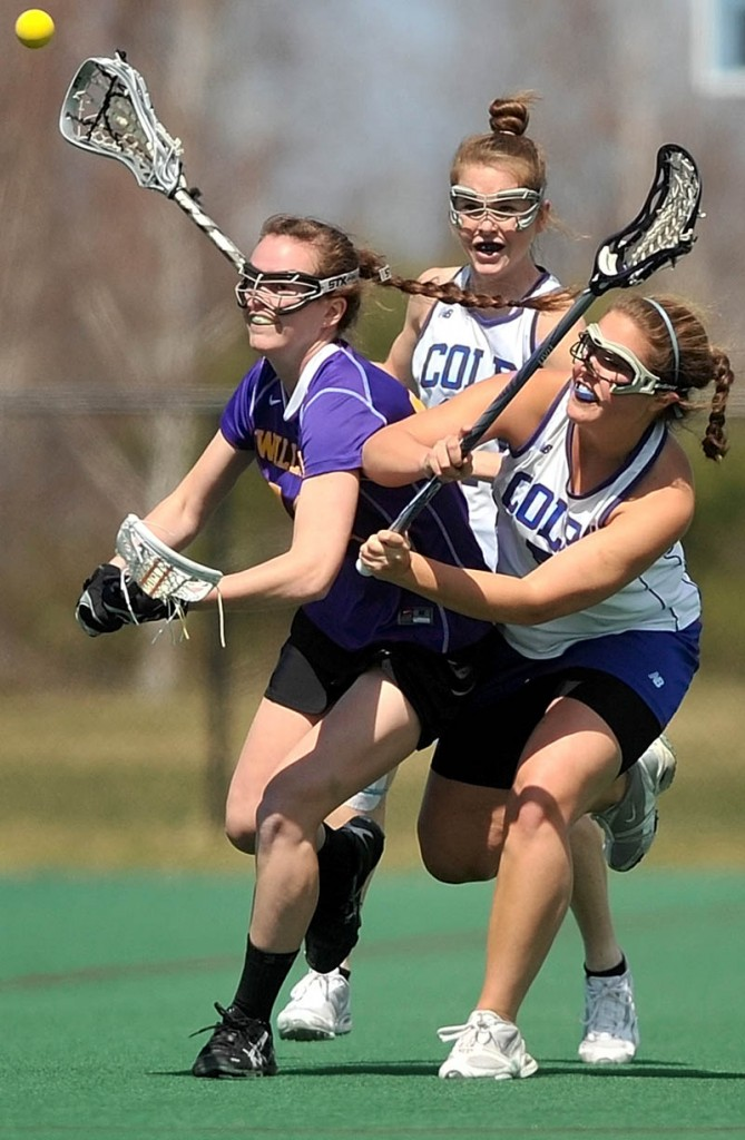 Staff Photo by Michael G. Seamans Williams College's Lacey Hankin, 12, left, battles with Colby Colleges Sarah Lux, 5, right and Kat McCarrick, 21, back, in the first period at Colby College in Waterville on Saturday.