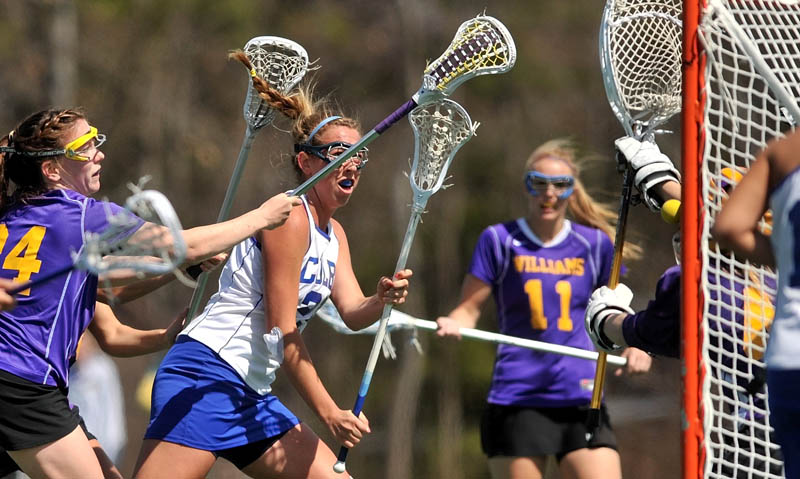 Staff Photo by Michael G. Seamans Colby College's Lindsey McKenna, 25, center left, takes a shot on Williams College goalie, Ali Pitch, 46, in the first period at Colby College in Waterville on Saturday.