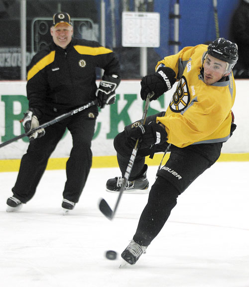 SHOOT IT: Boston Bruins head coach Claude Julien watches as forward Brad Marchand shoots the puck during team practice Monday in Wilmington, Mass. The Bruins face the Washington Capitals in Game 1 of their playoff series Thursday.