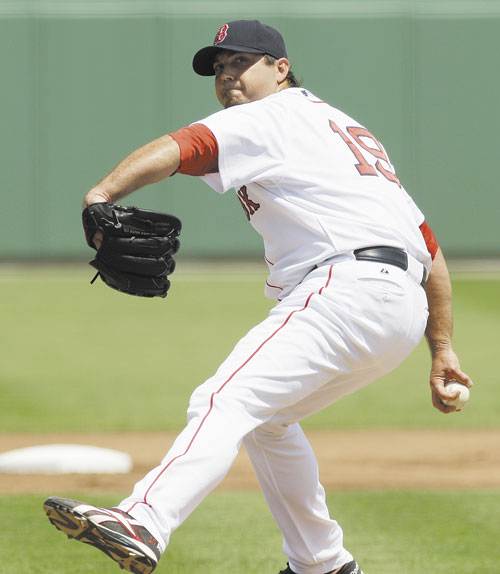 STAYING BEHIND: Boston Red Sox manager Bobby Valentine said pitcher Josh Beckett has a thumb injury and had it checked out Monday, but expected him to start the season Saturday against the Detroit Tigers.