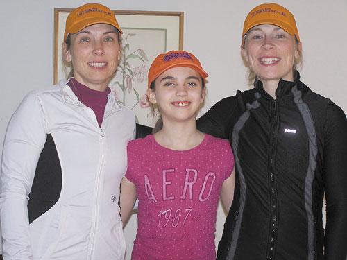FOR A CAUSE: Crystal White and Heather Peel, left, and right, will run in the Boston Marathon on April 16 in honor of White's daughter Tigerlily, who was born with biliary atresia, a rare liver disease.