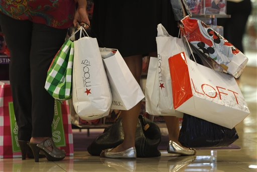 Shoppers at the Dadeland Mall in Miami. Retailers reported strong sales in March, in another sign the economy is improving. (AP Photo/ Lynne Sladky) Shoppers stop to look at a display while shopping at Dadeland Mall, Friday, Nov. 25 2011, in Miami. Early signs point to bigger crowds at the nation's malls and stores as retailers like Macy's and Target opened their doors at midnight. (AP Photo/ Lynne Sladky)