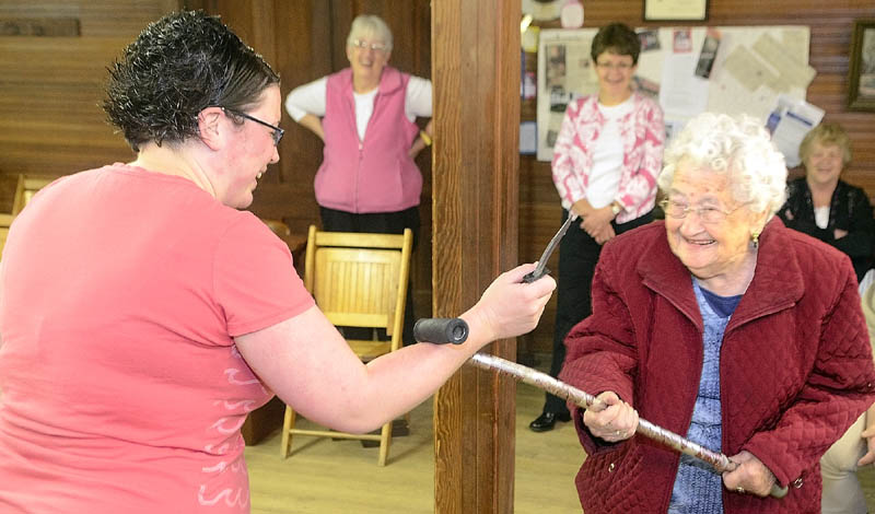 Instructor Karen Jones, owner of Tao Karate Club, is disarmed of her plastic knife by 95-year-old Bea Campbellton during a self-defense demonstration on Saturday morning at the Chlesea Grange.