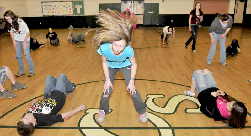 DANCE FEVER: Linda Riley, center, and other Carrabec Community School students rehearse dance routines at the school in North Anson recently.