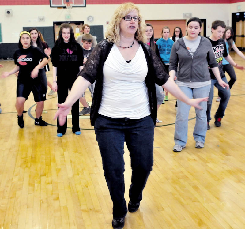 FOLLOW MY LEAD: Maine Dance Institute Director Jill Everett leads Carrabec Community School students in dance rehearsal recently.