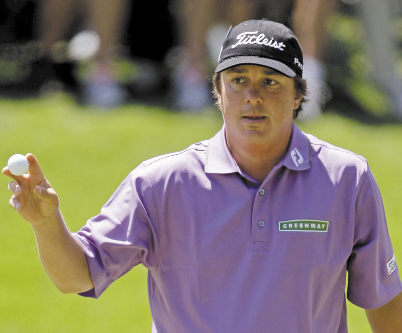 THANKS: Jason Dufner holds up his ball after a birdie on the 16th hole during the second of round the Masters on Friday in Augusta, Ga.