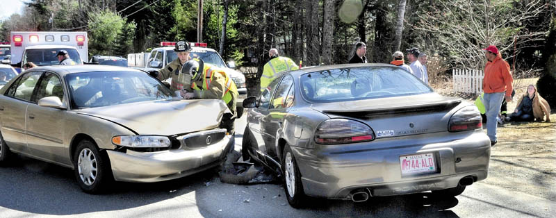 CRASH SCENE: Accident victim Julia Salsbury of Fairfield, right, is treated for injuries after her vehicle and another car driven by Lorraine Blaisdell, at left, collided on the Greene Road in Fairfield Center on Tuesday. Blaisdell may have suffered a medical condition prior to the accident, according to police.