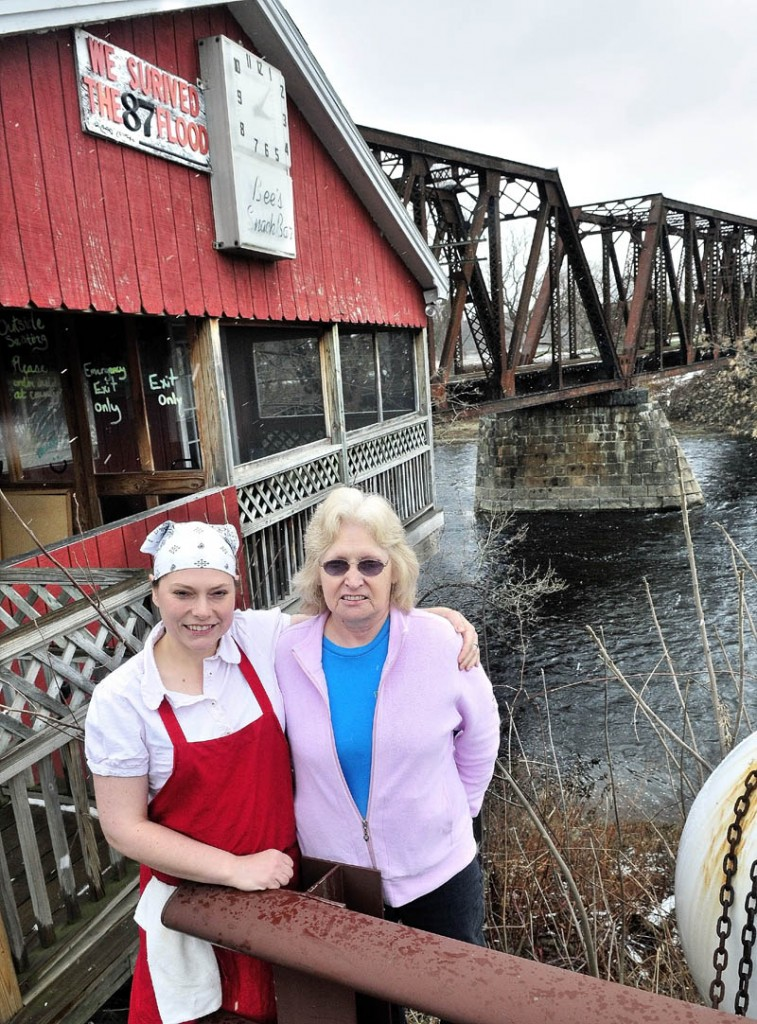 CLOSE CALL: Ryan Willette, left, and her mother Evelyn Willette stand outside their restaurant Bee's Snack Bar beside the Sebasticook River in Winslow recently. The business narrowly escaped being swept away during the flood of 1987.