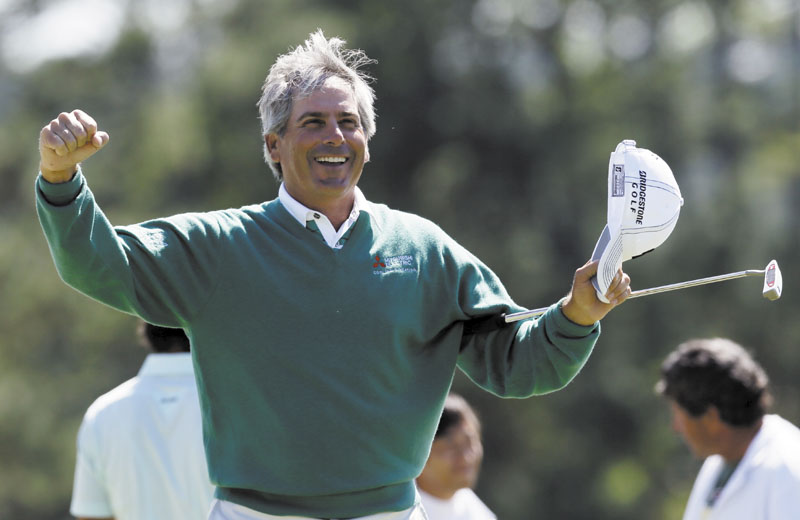 ANOTHER RUN: Fred Couples celebrates after finishing the second round of the Masters on Friday in Augusta, Ga. Couples, 52, shot 5-under 67 and is tied for the lead on the 20th anniversary of his title at Augusta National.