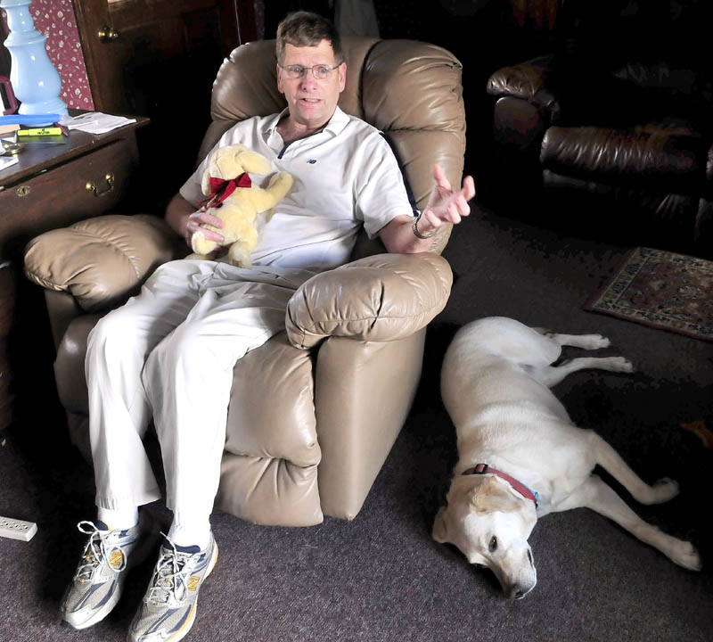 COMFORT: Karl Andresen of Winslow holds a stuffed dog in the likeness of his real dog Ruby given to him by his son Matthew while he was in the hospital after a crash March 18 in Waterville. Andresen said the toy gave him comfort for his mending broken ribs and assurance that he is cared for by others.
