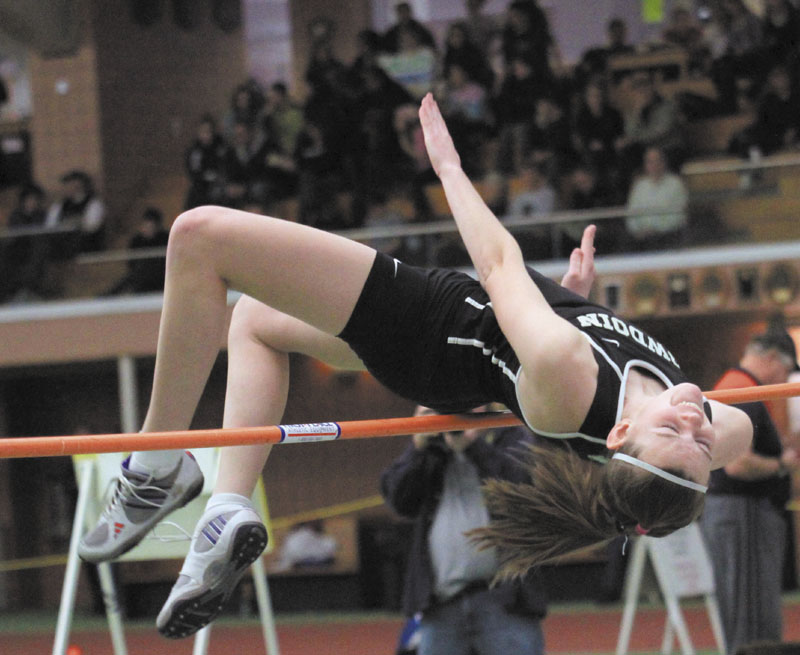 UP AND OVER: Bowdoin College's Hayleigh Kein won the high jump at the state indoor track and field championship in February with a leap of 5-feet, 2.25-inches.