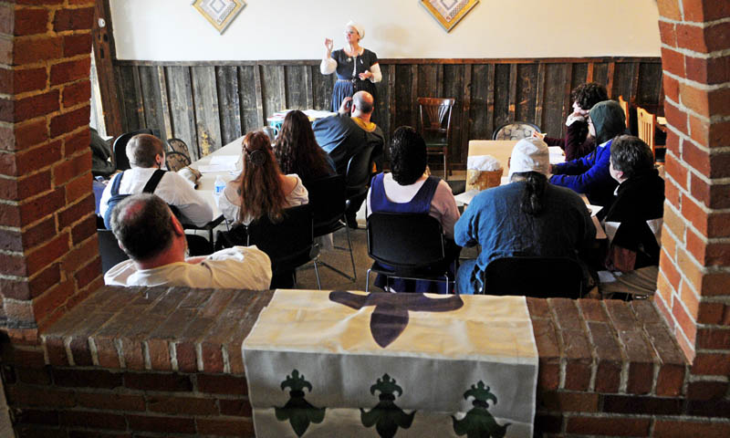 Mistress Suzanne Neuber de Londres teaches a class during The East Kingdom Brewers' Collegium event sponsored by the Society for Creative Anachronism on Saturday at the River Back Dance Club in Augusta.