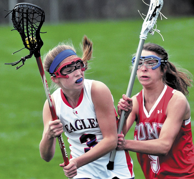 BATTLE IS ON: Cony's Josie Lee, right, defends Messalonskee Sara Gernier during the Rams' 11-10 win Thursday in Messalonskee.