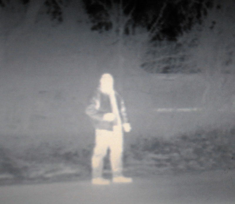 Kennebec County Sheriff Deputy Mike Dutil is seen through a thermal imaging camera on his crusier