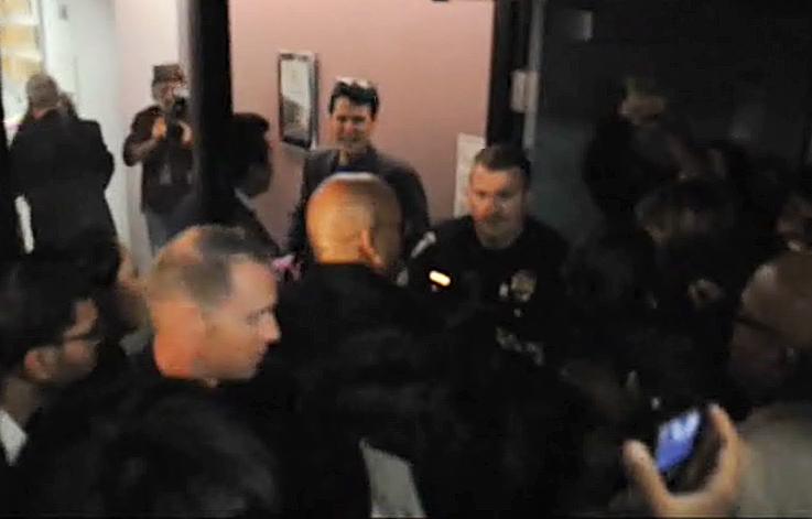 Image from video of student confrontation at Santa Monica College. Students have been upset over a plan to form a nonprofit foundation to offer core courses for about $600 each, or about four times the current price.
