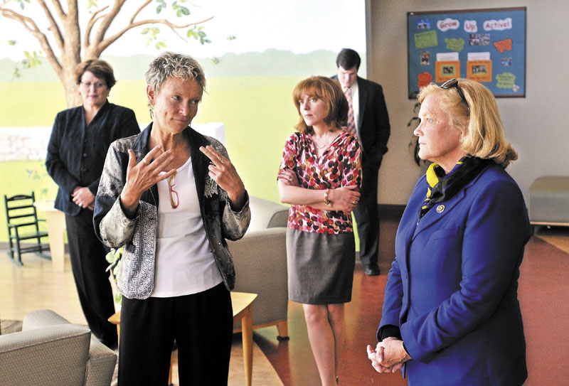 TOUR: Waterville mayor Karen Heck, left, talks to U.S. Rep. Chellie Pingree, D-1st District, right, during a tour of Educare Central Maine on Wednesday. Seen in the background is Kathy Colfer, left, director of Child and Family Services at KVCAP, and Lauren Sterling, center, philanthropy specialist for Educare Central Maine.