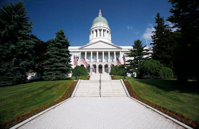 In this June 9, 2011 photo, the State House is seen in Augusta, Maine. The Maine House passed a bill Thursday that would lower the state income tax to 4 percent. (AP Photo/Robert F. Bukaty)