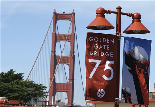 In this photo taken Wednesday, April, 18, 2012, a sign marking its 75th anniversary is shown near the Golden Gate Bridge in San Francisco. The bridge was heralded as an engineering marvel when it opened in 1937. It was the world's longest suspension span and had been built across a strait that critics said was too treacherous to be bridged. But as the iconic span approaches its 75th anniversary, the engineers who have overseen it all these years say keeping it up and open has been a feat unto itself. (AP Photo/Eric Risberg)