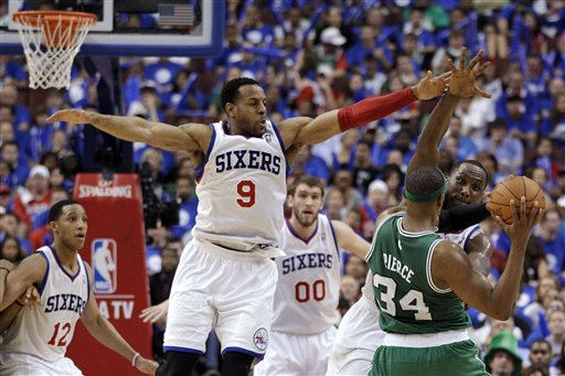Boston Celtics' Paul Pierce (34) looks to pass as Philadelphia 76ers' Elton Brand, Spencer Hawes, Andre Iguodala and Evan Turner, from right, defend during the second half of Game 6 of an NBA basketball Eastern Conference semifinal playoff series, Wednesday, May 23, 2012, in Philadelphia. Philadelphia won 82-75. (AP Photo/Matt Slocum)