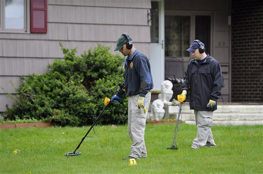 Law enforcement agents search the yard at the home of reputed Connecticut mobster Robert Gentile in Manchester, Conn., today. Gentile's lawyer A. Ryan McGuigan says the FBI warrant allows the use of ground-penetrating radar and believes they are looking for paintings stolen in 1990 from Boston's Isabella Stewart Gardener Museum worth half a billion dollars.