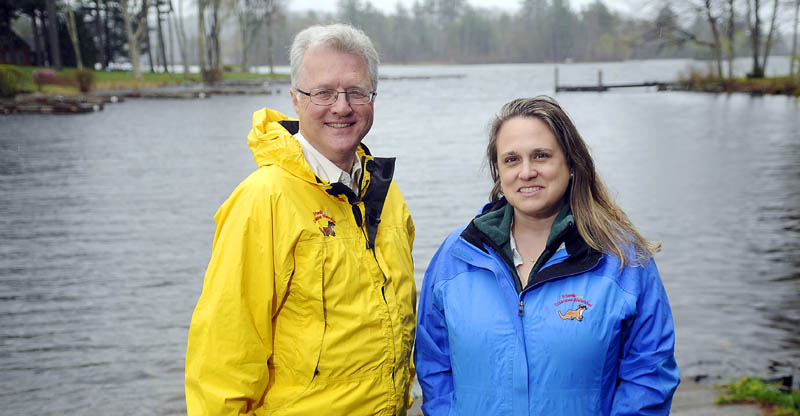Former car dealer John Blouin, left, is the new executive director of the Friends of the Cobbossee Watershed, while longtime employee Tamara Whitmore has been promoted to education and programs director of the group. Whitmore and Blouin, seen at the Manchester boat landing on Lake Cobbosseecontee last week, will head a nonprofit group that aims to educate residents of the watershed and improve water quality.