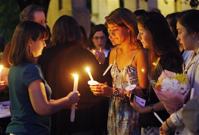 Boston University students including Tori Pinheiro, third right, of New Bedford, Mass., and Austin Brashears' girlfriend, holds a candlelight vigil on Marsh Plaza at Boston University, Saturday, May 12, 2012, in Boston, for three students studying in New Zealand who were killed when their minivan crashed during a weekend trip. Daniela Lekhno, 20, of Manalapan, N.J.; Austin Brashears, 21, of Huntington Beach, Calif.; and Roch Jauberty, 21, whose parents live in Paris, were killed as they traveled in a minivan Saturday near the North Island vacation town of Taupo when the vehicle drifted to the side of the road and then rolled when the driver tried to correct course. (AP Photo/Bizuayehu Tesfaye)