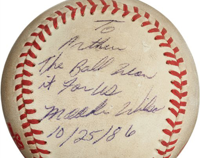 "The ""Buckner Ball,"" the baseball that dribbled between the legs of Boston Red Sox first baseman Bill Buckner during the 10th inning of Game Six of the 1986 World Series. The error gave the New York Mets the win and the team went on to beat the Red Sox the next night to win the World Series. The writing, by Mookie Wilson addressed to Mets traveling secretary Arthur Richman says: ""To Arthur, the ball won it for us, Mookie Wilson, 10/25/86."" Heritage Auctions says the ball is expected to bring in more than $100,000 on Friday."