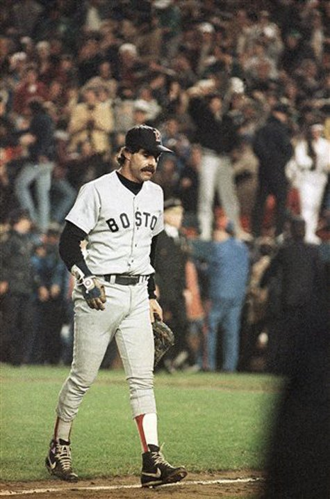 Boston Red Sox first baseman Bill Buckner is a picture of dejection as he leaves the field on Oct. 25, 1986, after committing an error on a ball hit by New York Mets' Mookie Wilson, which allowed the winning run to score in the sixth game of the World Series, in New York.
