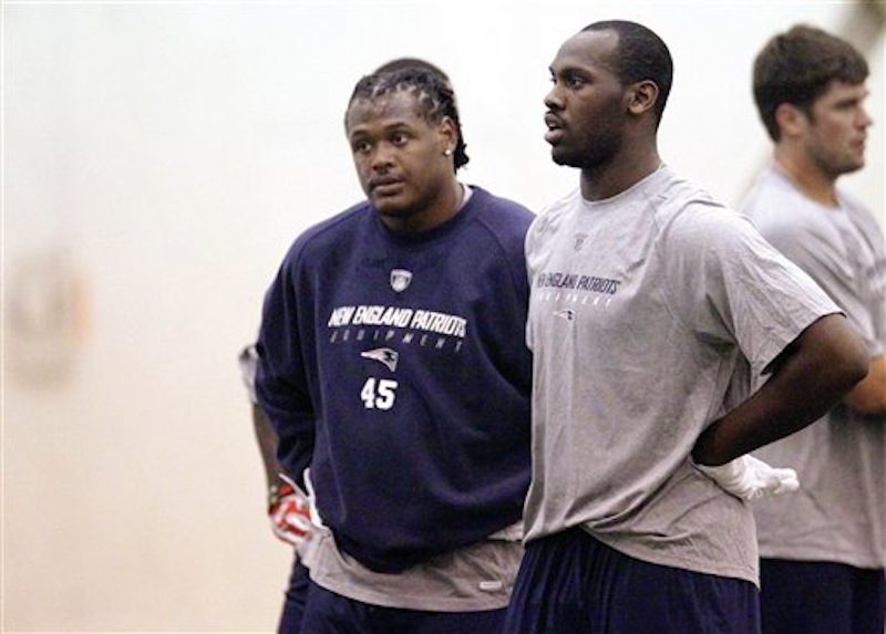 New England Patriots defensive rookie players Dont'a Hightower (45) and Chandler Jones, both selected in the first round of the draft, catch their breath during NFL football rookie minicamp at the team's facility in Foxborough, Mass., Friday, May 11, 2012. (AP Photo/Stephan Savoia)