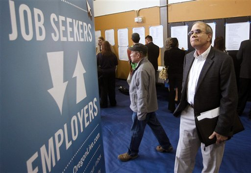 Job seeker Alan Shull attends a job fair recently in Portland, Ore. The Labor Department said today that the economy added just 115,000 jobs in April. as U.S. employers pulled back on hiring for the second straight month.