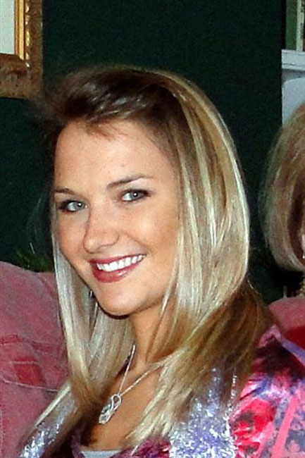 """This undated photo provided by the family shows Aimee Copeland. the 24-year-old Georgia graduate student is fighting to survive a flesh-eating bacterial infection. Copeland has learned she will lose her hands and remaining foot, and responded by saying """"Let's do this."""" Her father recounted the conversation in an update on his Facebook page Friday, May 18, 2012. Andy Copeland wrote about the difficult talk he had a day earlier with his daughter Aimee. The 24-year-old woman contracted the bacteria after an accident. (AP Photo/Copeland Family)"""