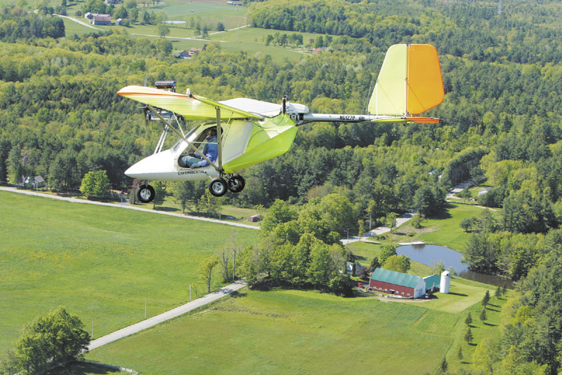 Shawn Moody flies an experimental aircraft over Gorham on Friday, May 18, 2012. Moody and his friend John Pompeo have been flying the experimental aircraft for 20 years. Moody is looking to move the grass landing strip behind his Gorham home in order to gain a longer runway.