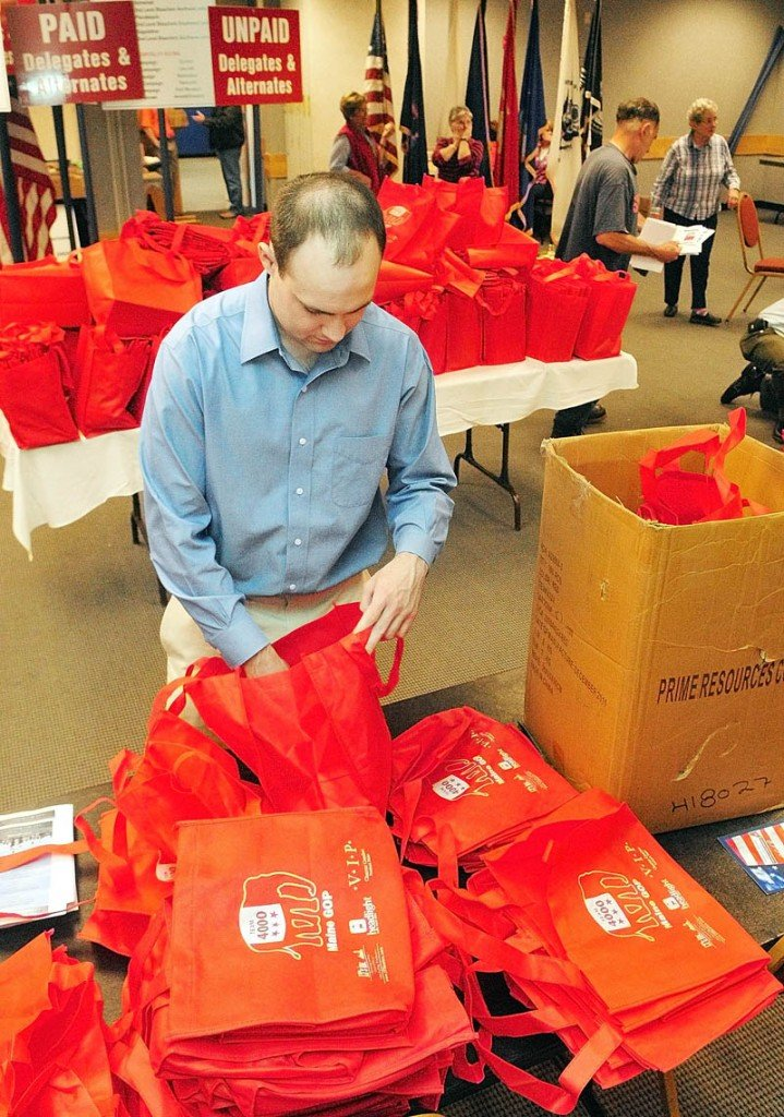 John McMahon, a volunteer for the Mitt Romney campaign from New Hampshire, stuff leaflets into bags that will be given to Republican state party convention delegates and alternates on Friday afternoon at the Augusta Civic Center. The state Republican convention opens this morning and runs through Sunday.