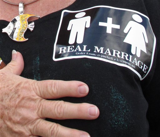 Jennifer Cockrham, a nurse from Walkertown, N.C., holds her hand over her heart for the Pledge of Allegiance during a rally supporting a constitutional ban on gay marriage in Raleigh, N.C., recently.