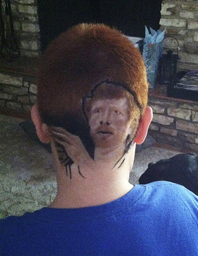 This family photo shows Patrick Gonzalez, 12, with an image of San Antonio Spurs' Matt Bonner shaved into his head. He returned to school Thursday after reluctantly shaving his head.