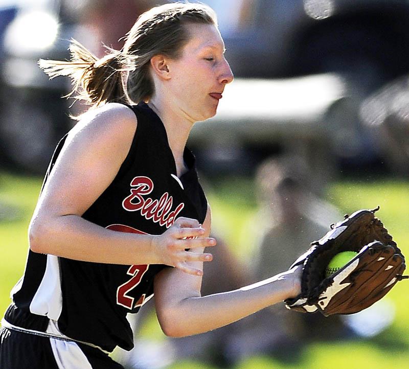 Staff photo by Andy Molloy GRAB: Hall-Dale High School's Emily Maynard snags a line drive Monday at second during a softball match up against Monmouth Academy at Monmouth.
