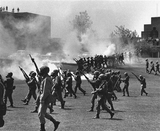 In this May 4, 1970, photo, Ohio National Guard troops move in on rioting students at Kent State University in Kent, Ohio. Four people were killed and 11 wounded when the Guardsmen opened fire.