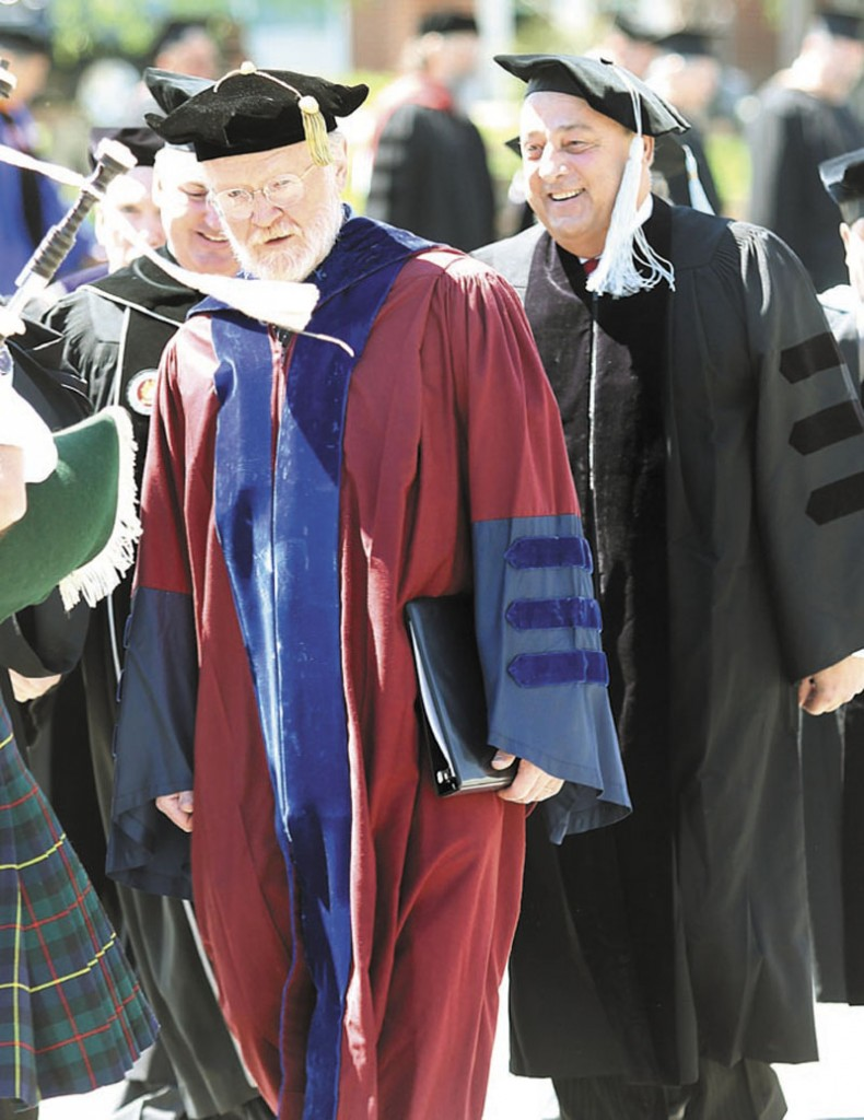 Retiring Thomas College President Dr. George Spann takes part in his final processional just ahead of Gov. Paul LePage at the start of the 118th commencement Saturday in Waterville. Spann served as president for 23 years.