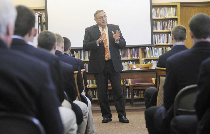 IMPORTANT MESSAGE: Gov. Paul LePage speaks with Cheverus High School's football team Wednesday about domestic violence. The team, which visited LePage at the Blaine House after winning the state championship last fall, signed a petition Wednesday to stand behind the governor in his efforts to end domestic violence.