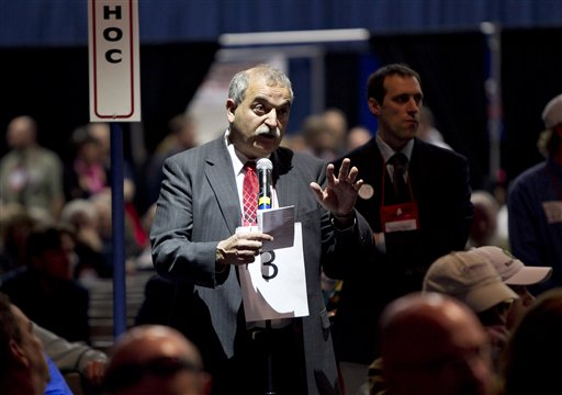 State party chairman Charlie Webster addresses the Republican convention to urge leaders to try to wrap up business on time Sunday at the Augusta Civic Center.