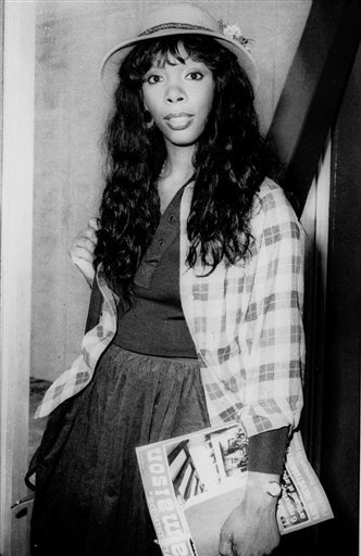 In this Oct. 21, 1977, photo, Donna Summer, 27, arrives at Heathrow Airport from Paris.