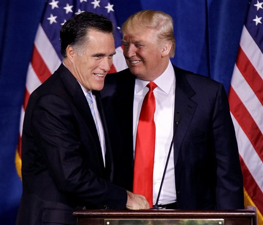 Donald Trump greets Republican presidential candidate Mitt Romney during a news conference in Las Vegas in this Feb. 2, 2012, photo.